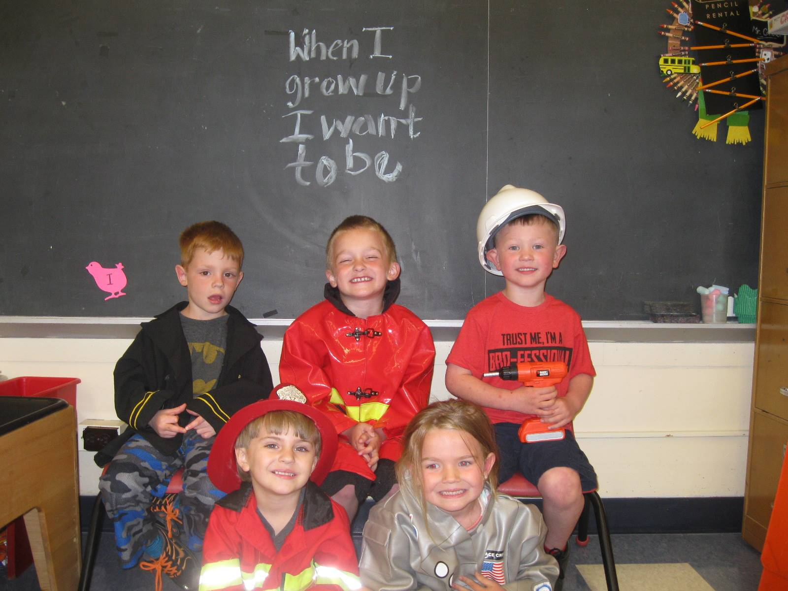 5 students dressed up as a Community Helper