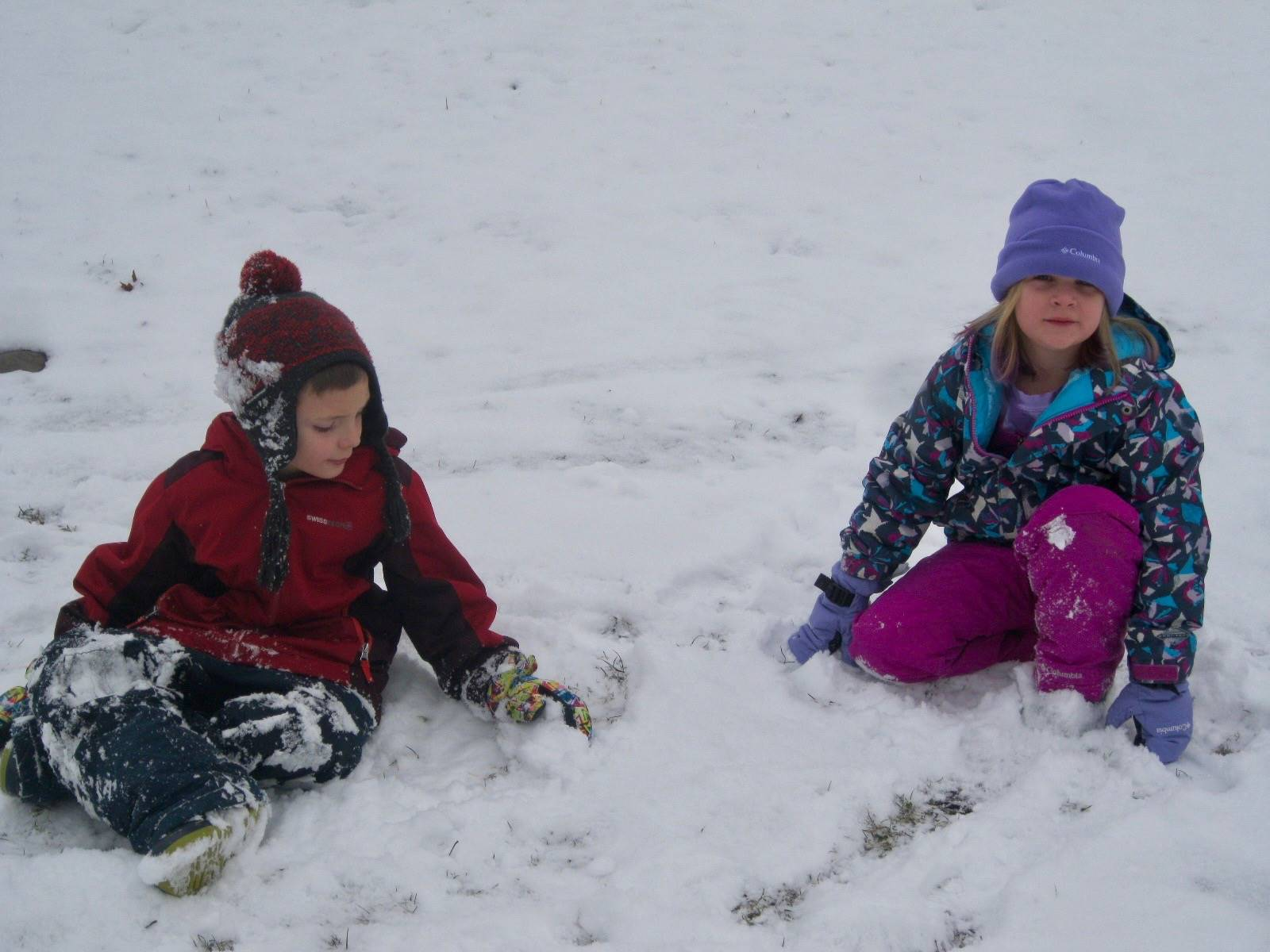 2 students playing in the snow