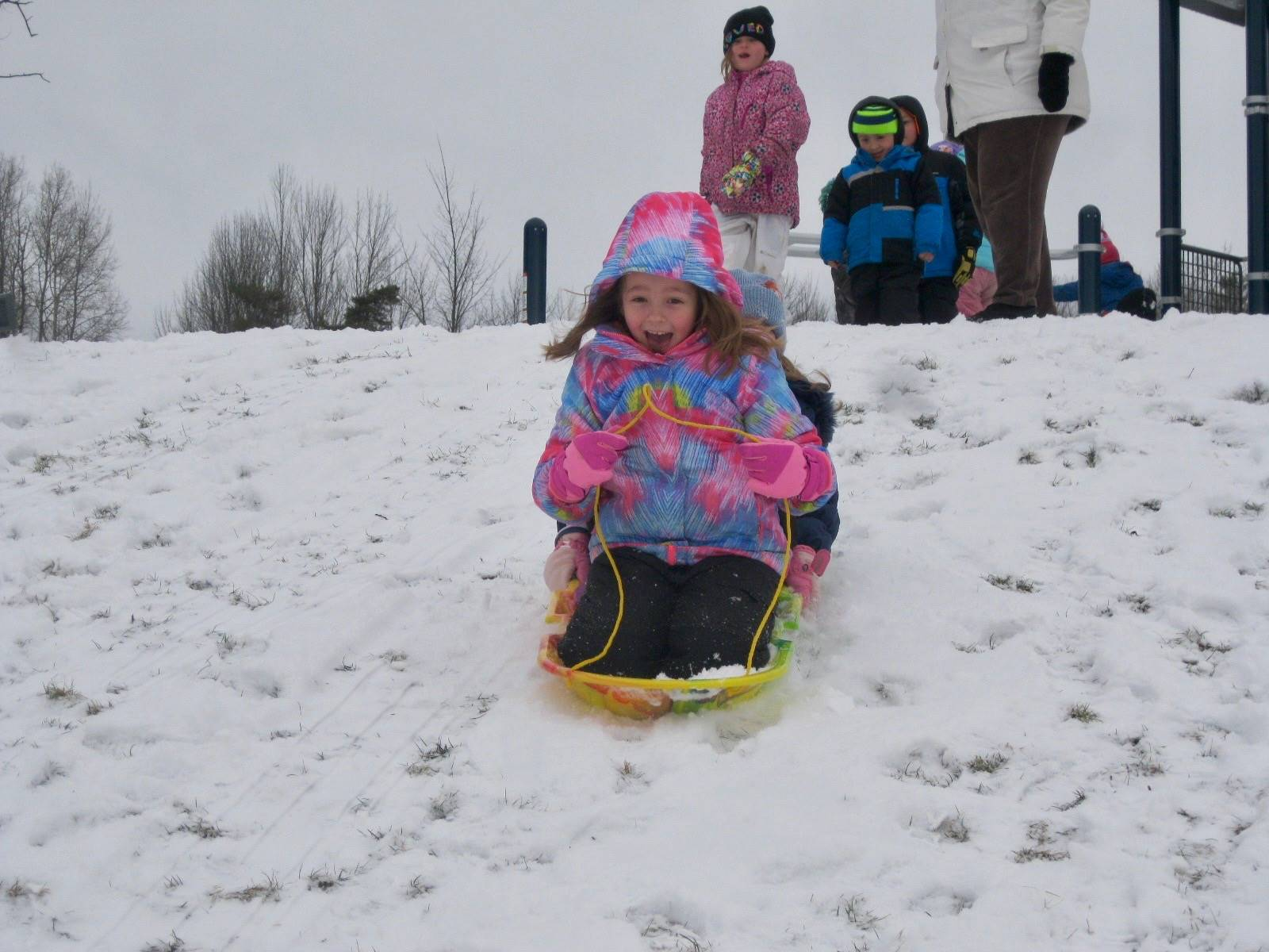 A student sliding down the hill.