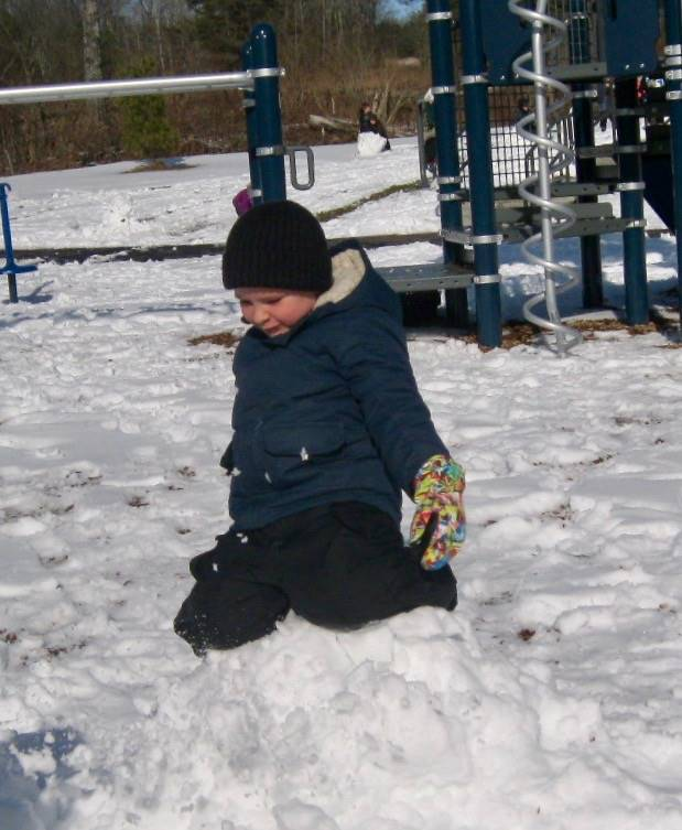 A student perched on top of a snowball