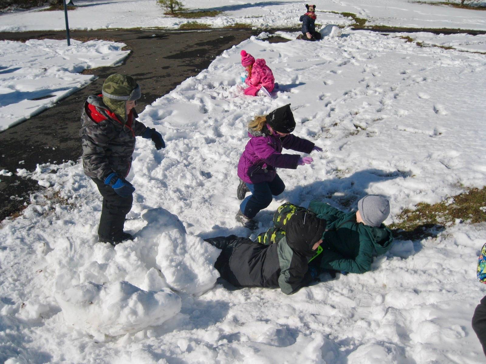 Students jumping in snow.