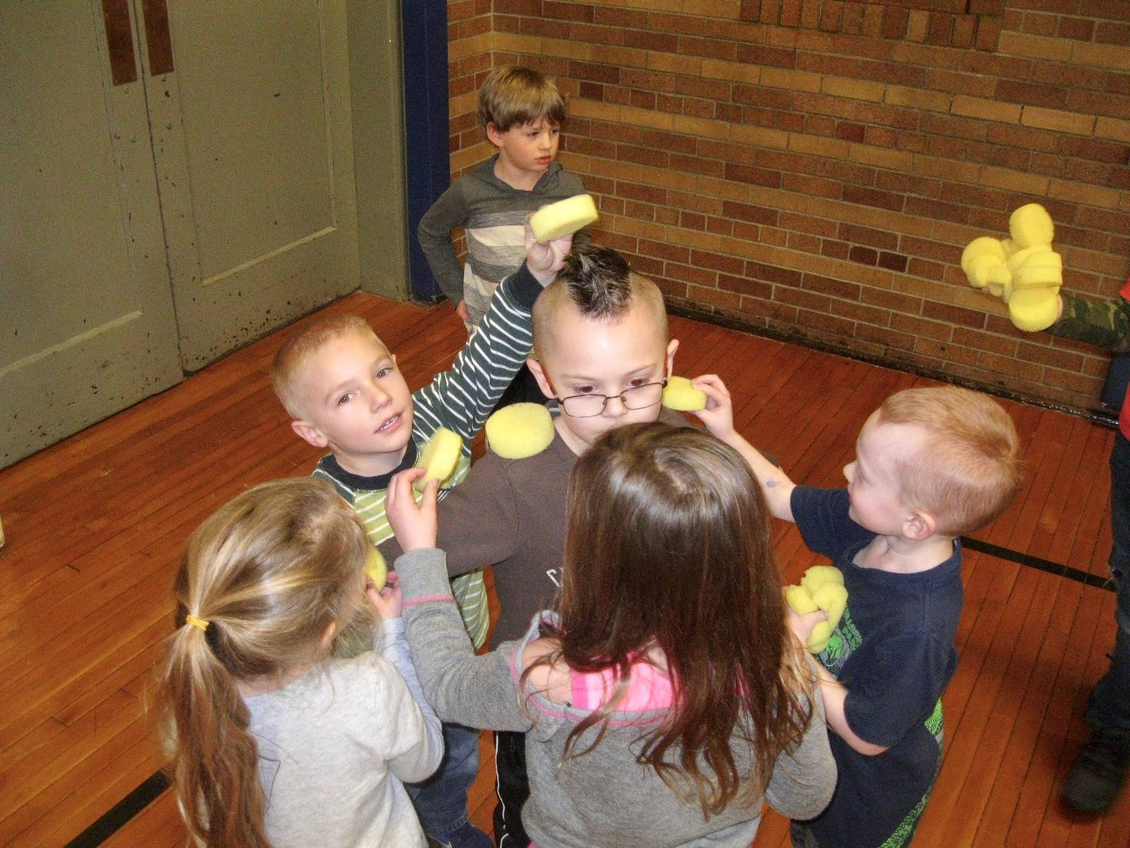 A group of kindergarteners playing a cooperative game.