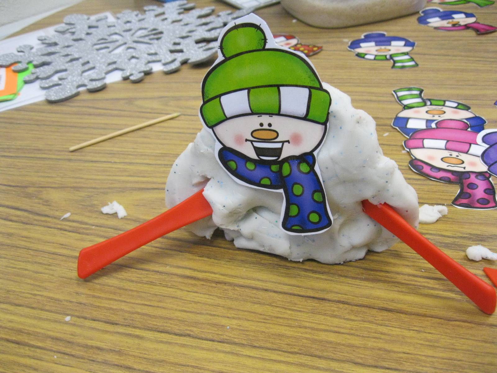 An excited played snowman.