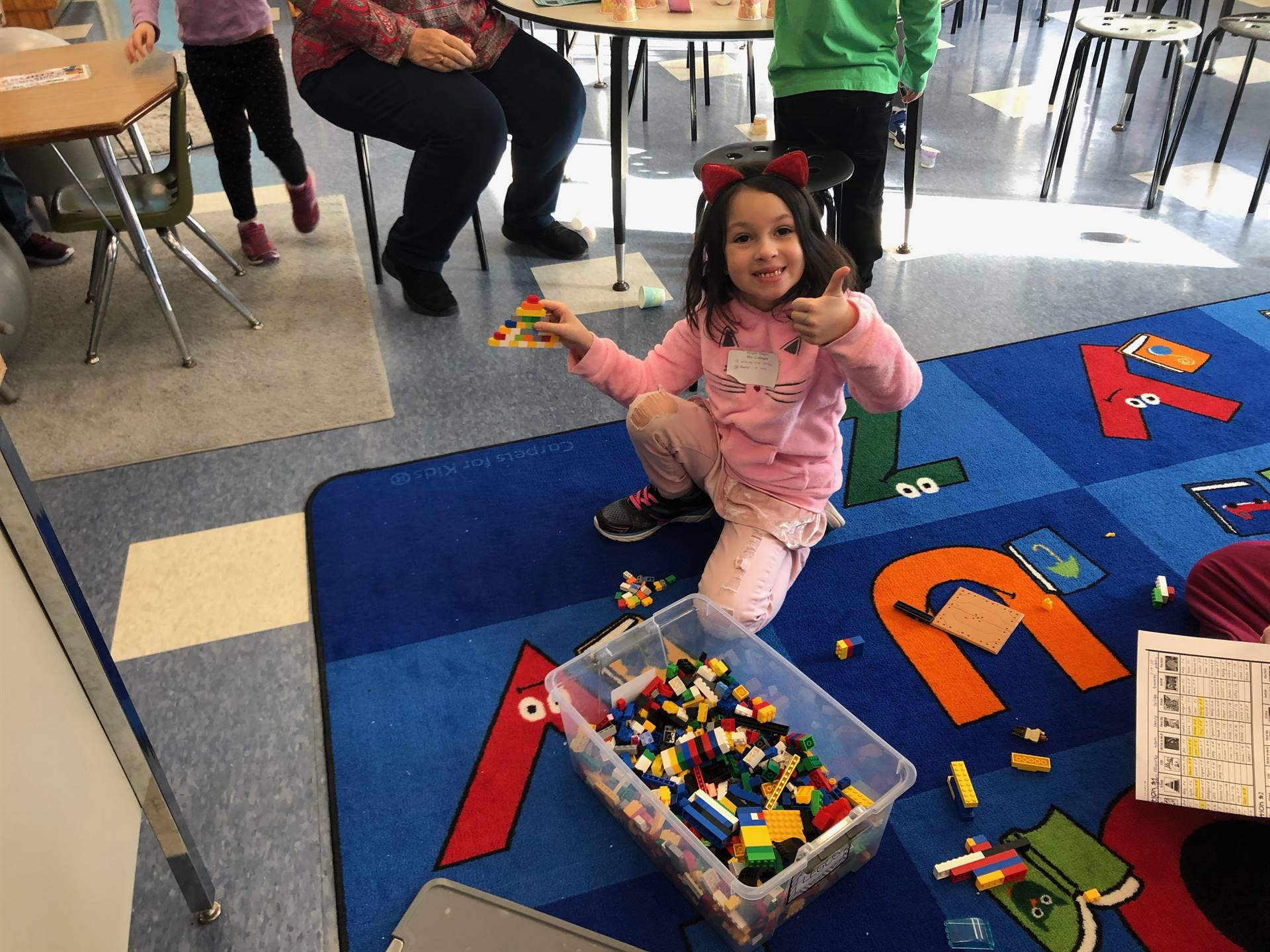 a student builds with 100 legos.