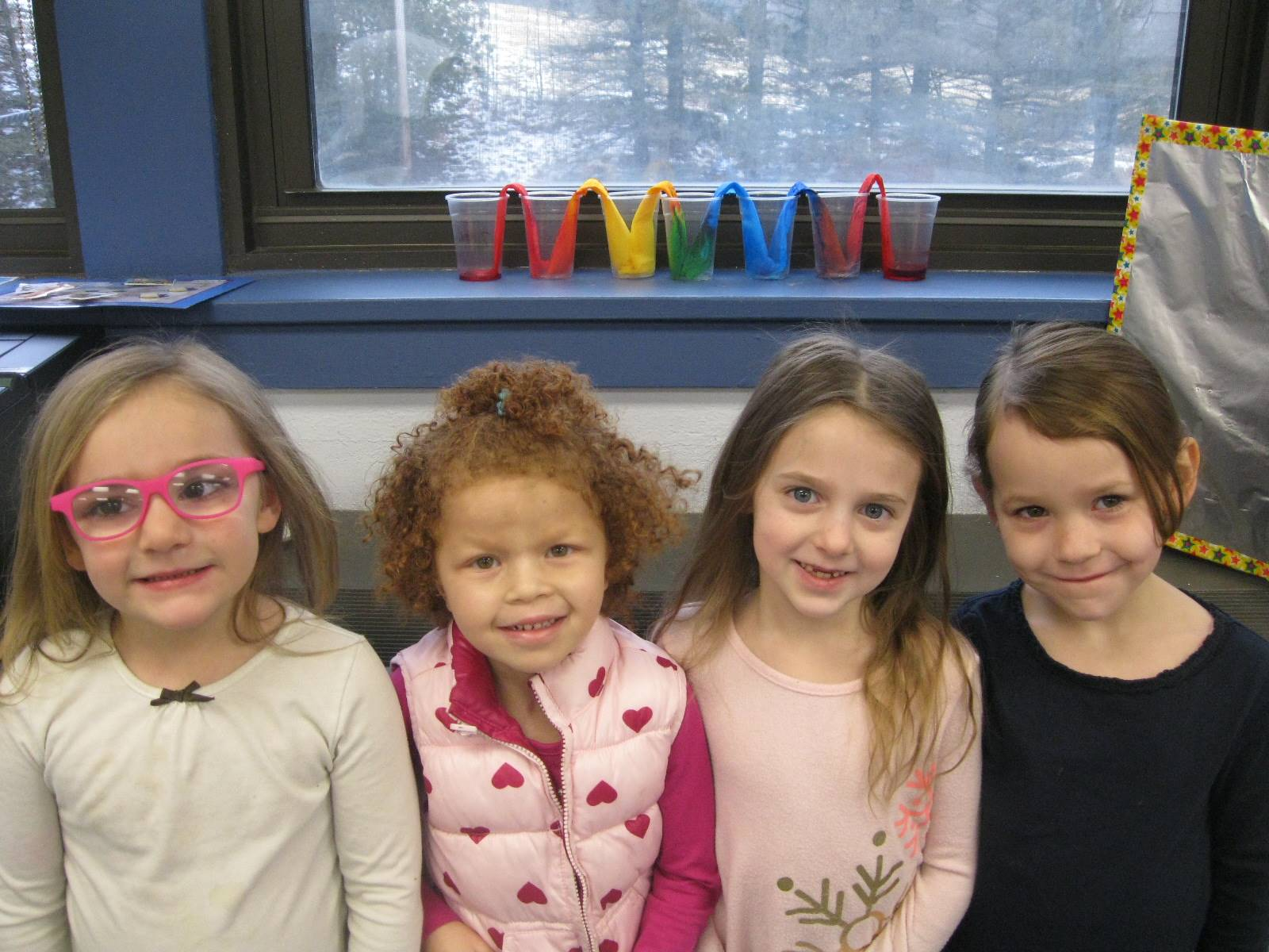 """4 students show off their """"rainbow"""" friendship project!"""