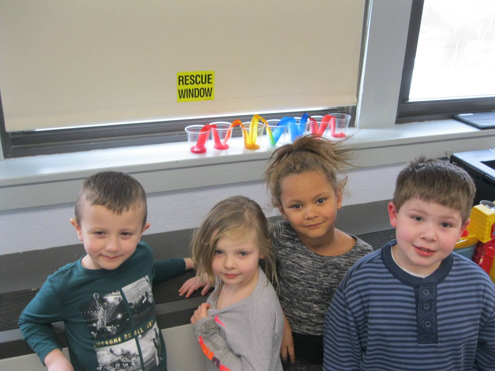 """4 students with their """"rainbow"""" friendship project!"""