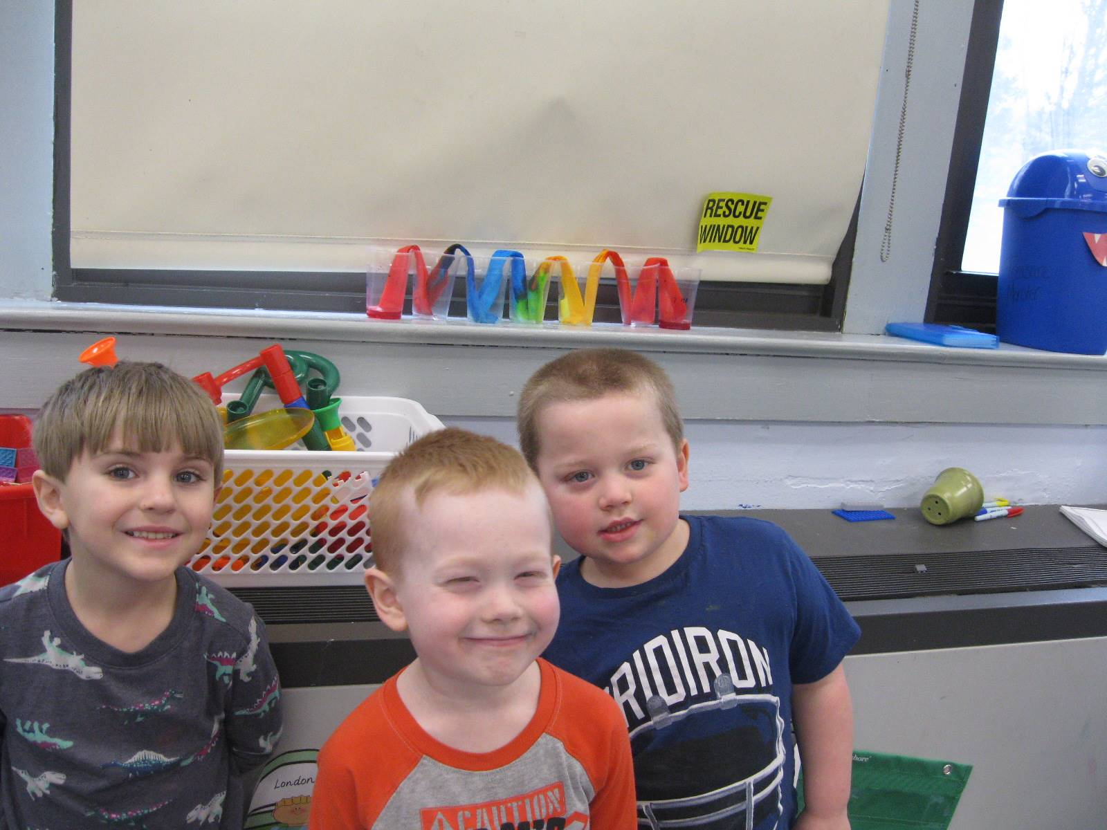 """3  students show off their """"rainbow"""" friendship project!"""