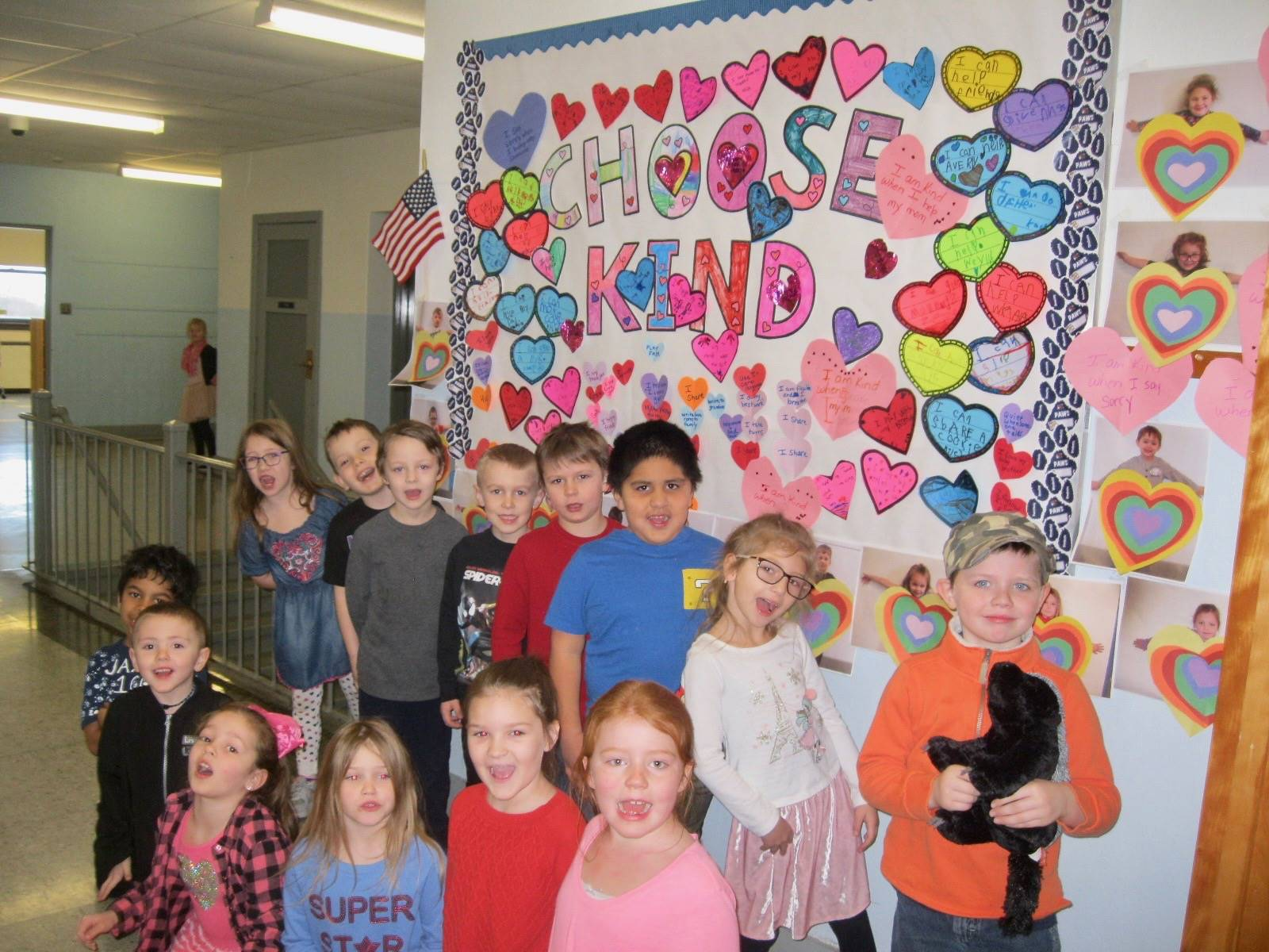 "Students show off ""Choose Kind"" Bulletin Board."