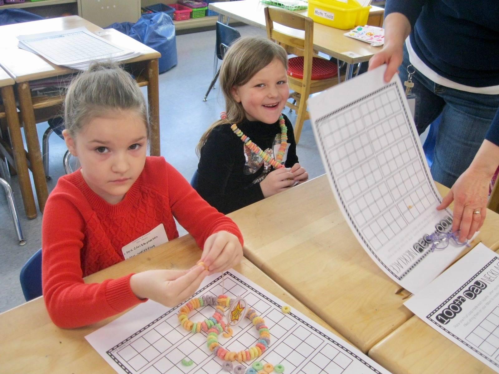 2 students create 100 piece necklace.