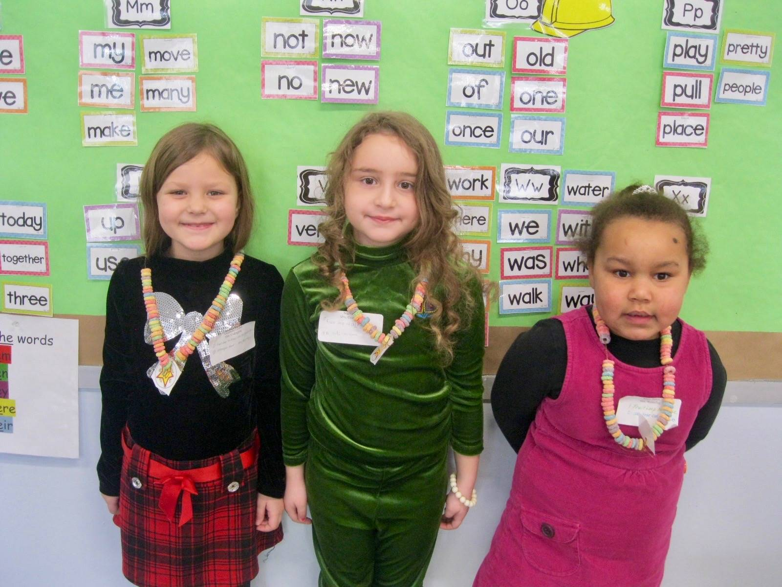 3 students show 100 piece necklace.