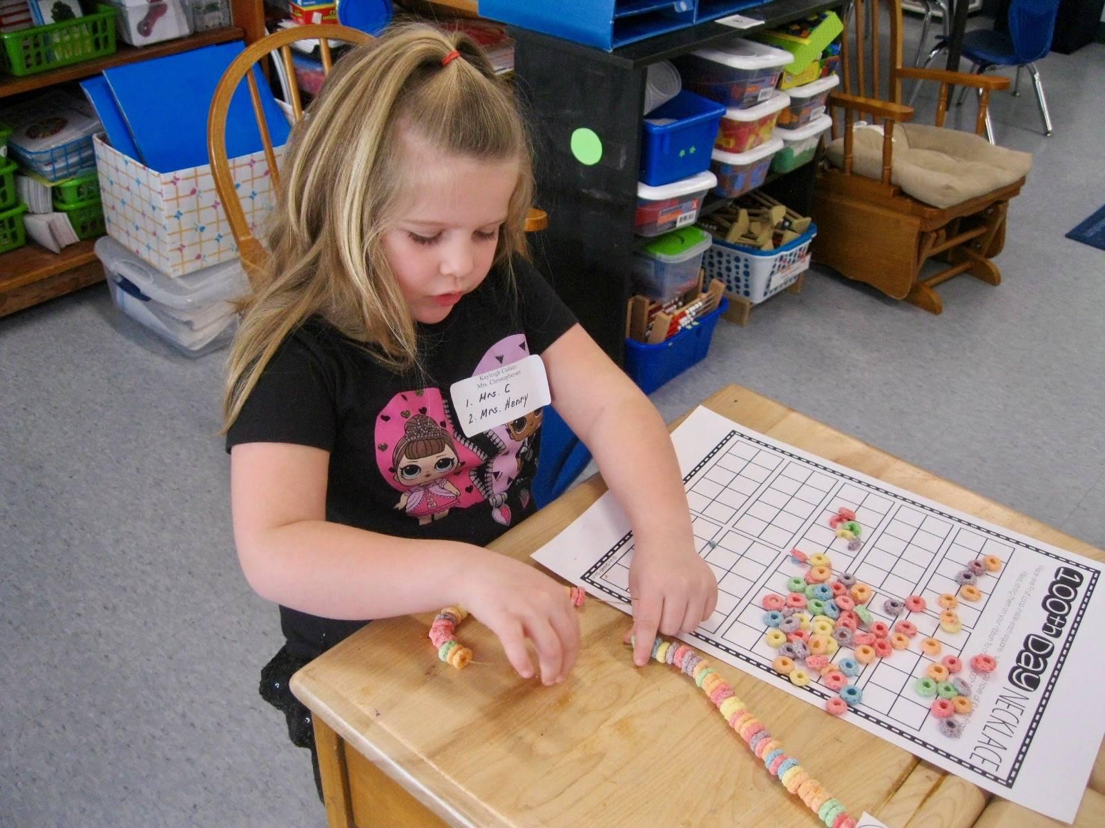 1 student creates 100 piece necklace.