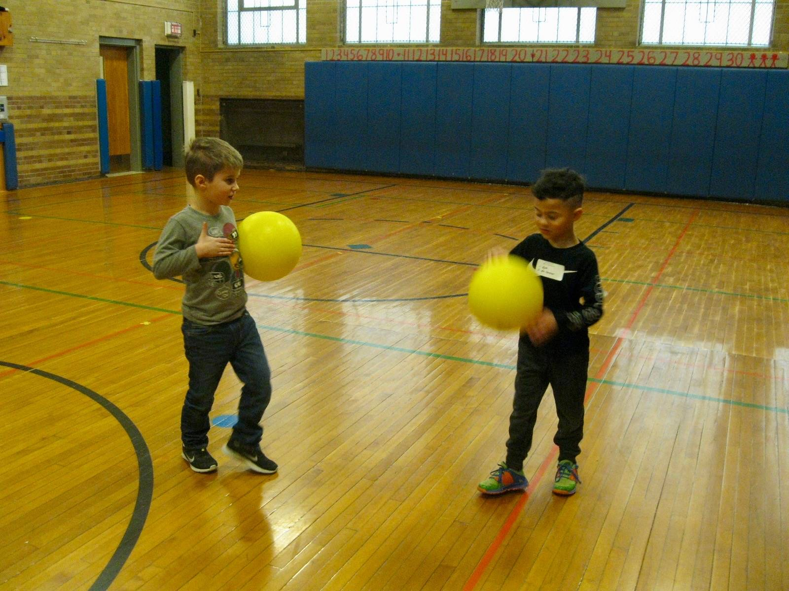 2 students bounce ball 100 times.