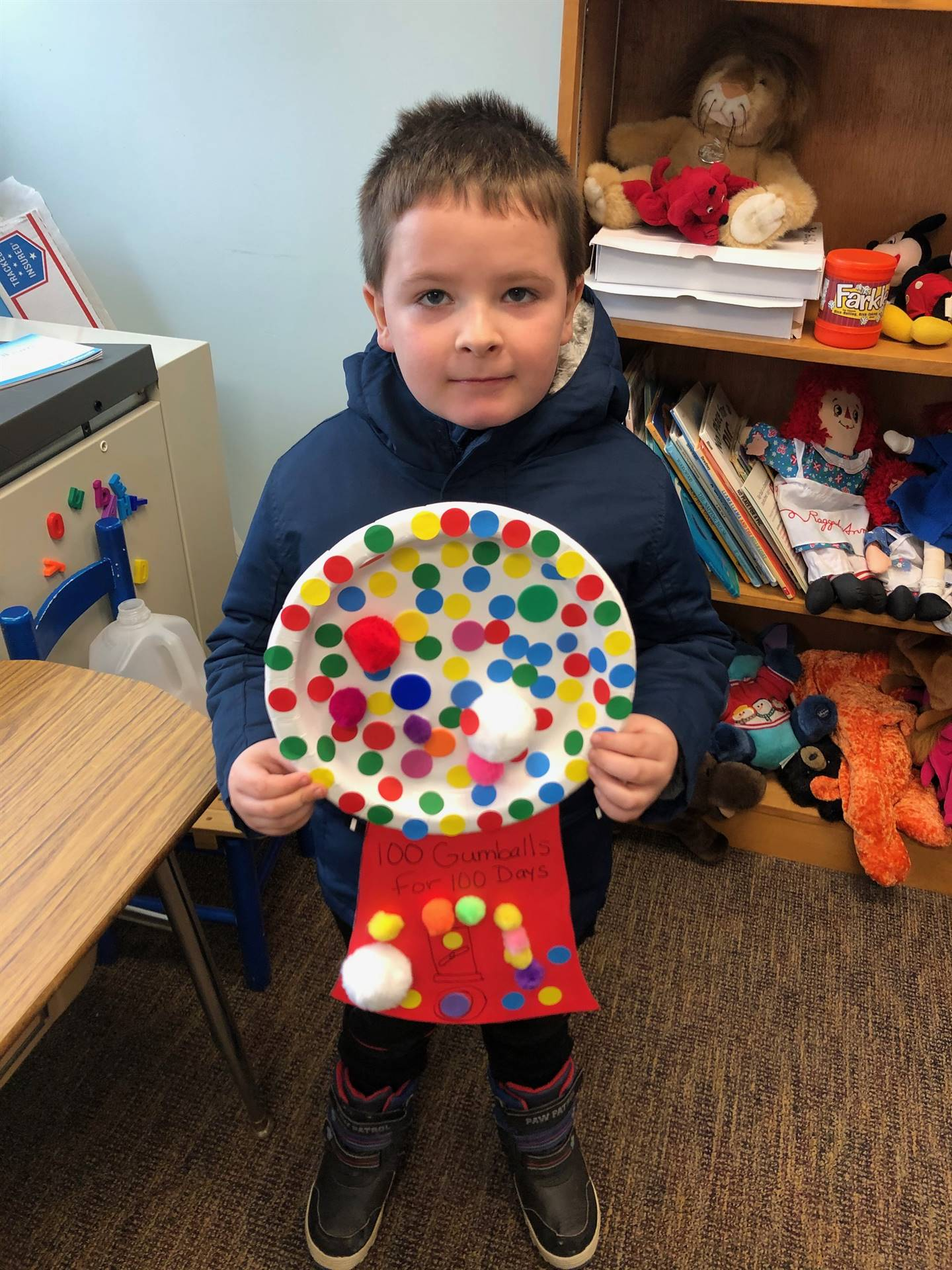 a student with a gumboil machine project
