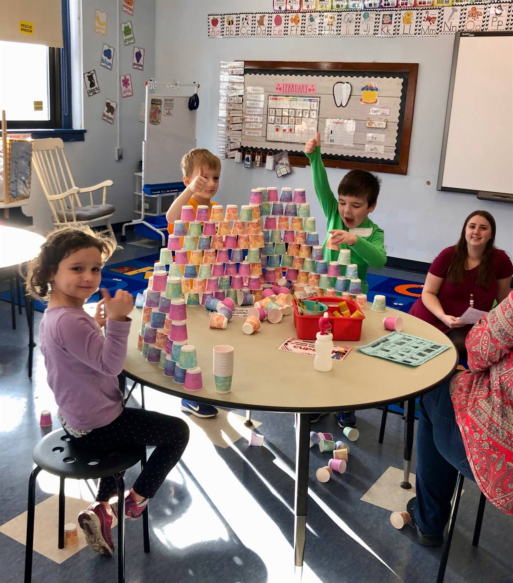 A group os students doing 100th day cup stack project.