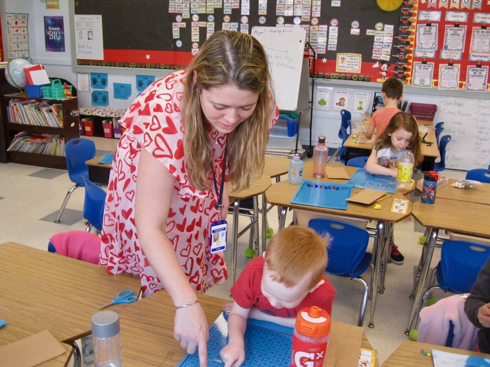 A teacher helps a student count 100 items.