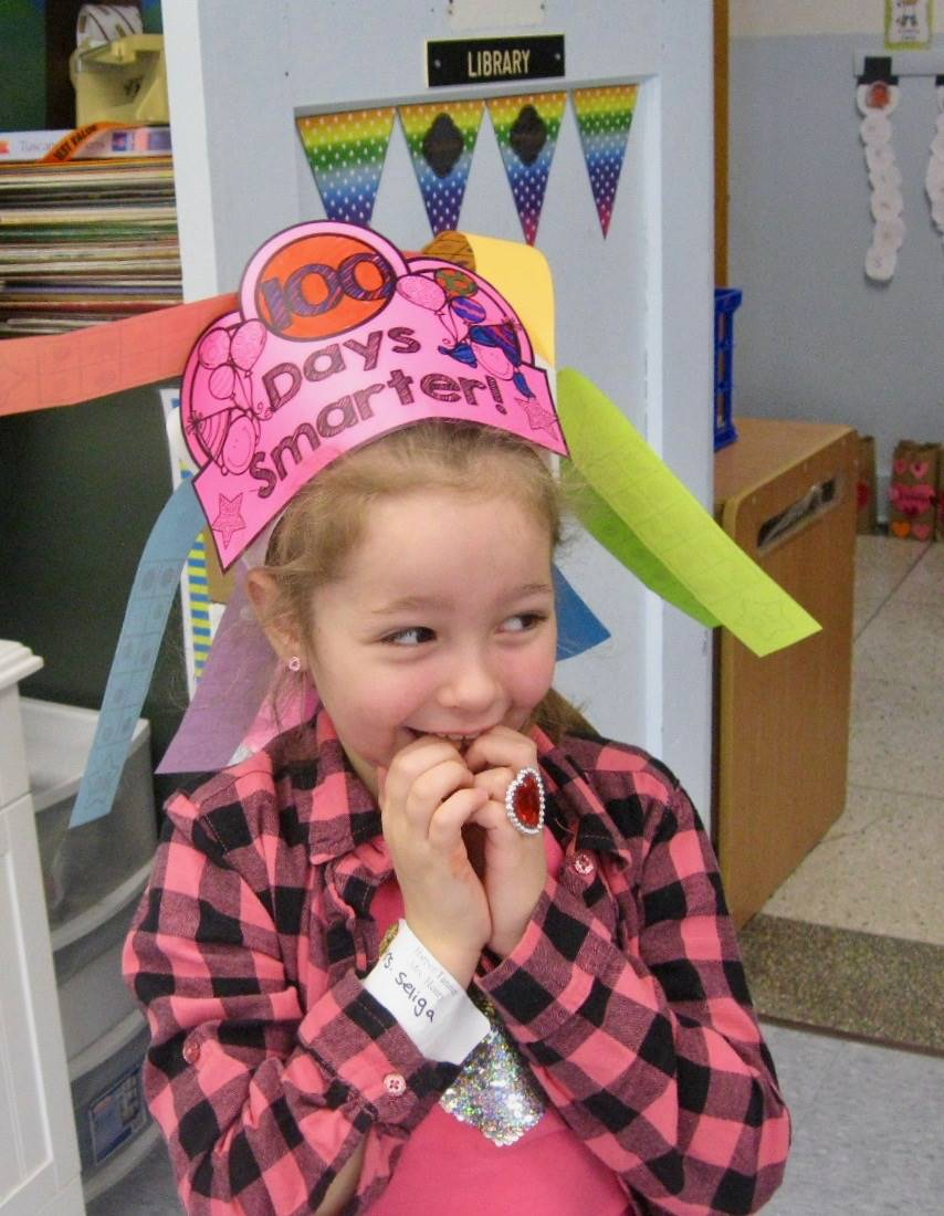 a student with a 100 days smarter hat.