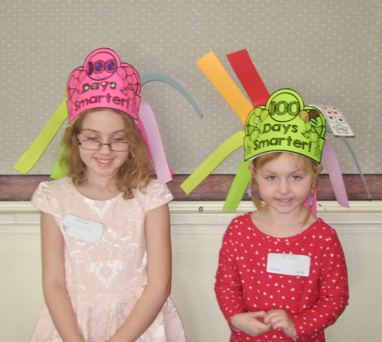 2 students with 100 days smarter hats.