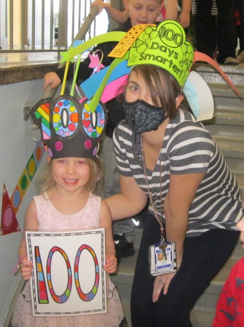 The 100th student with a staff member!