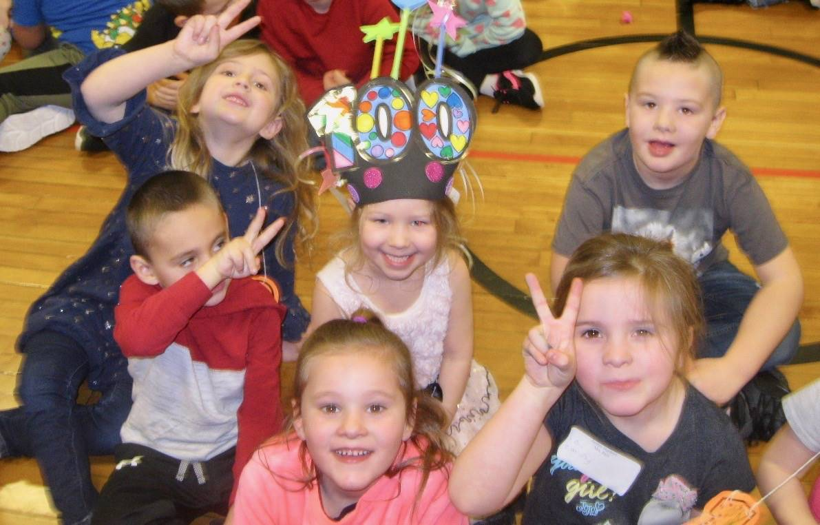 6 students at 100th day assembly.