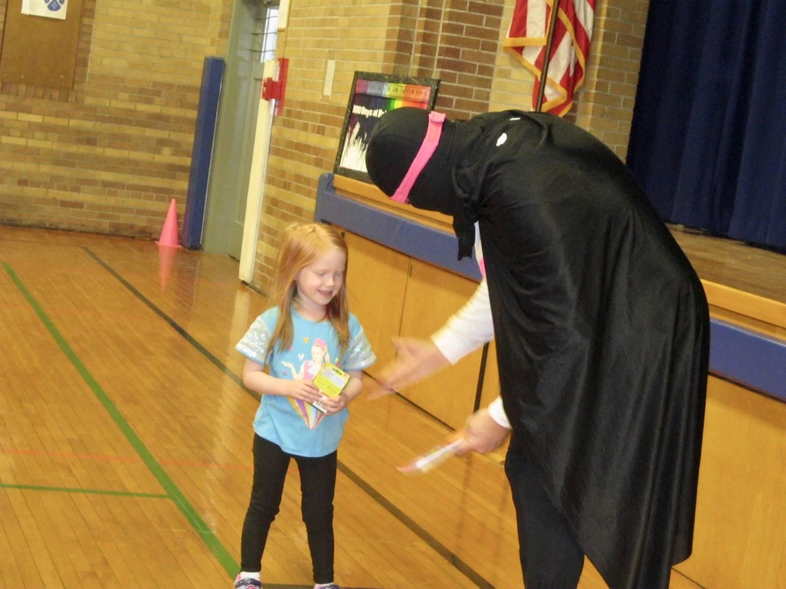 Zero does a magic trick with a  helper