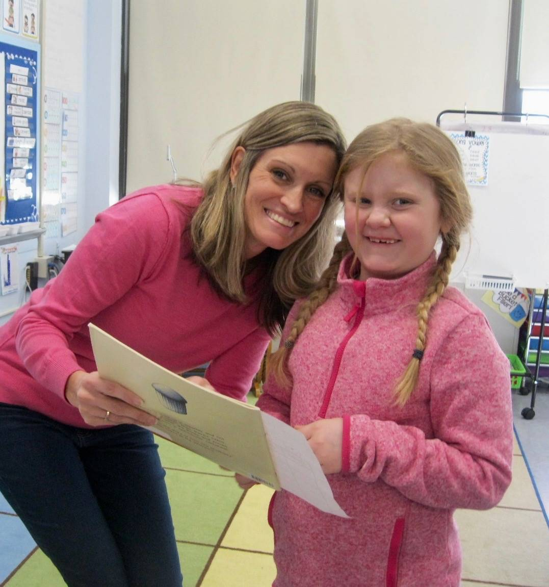 A staff member and student share love.