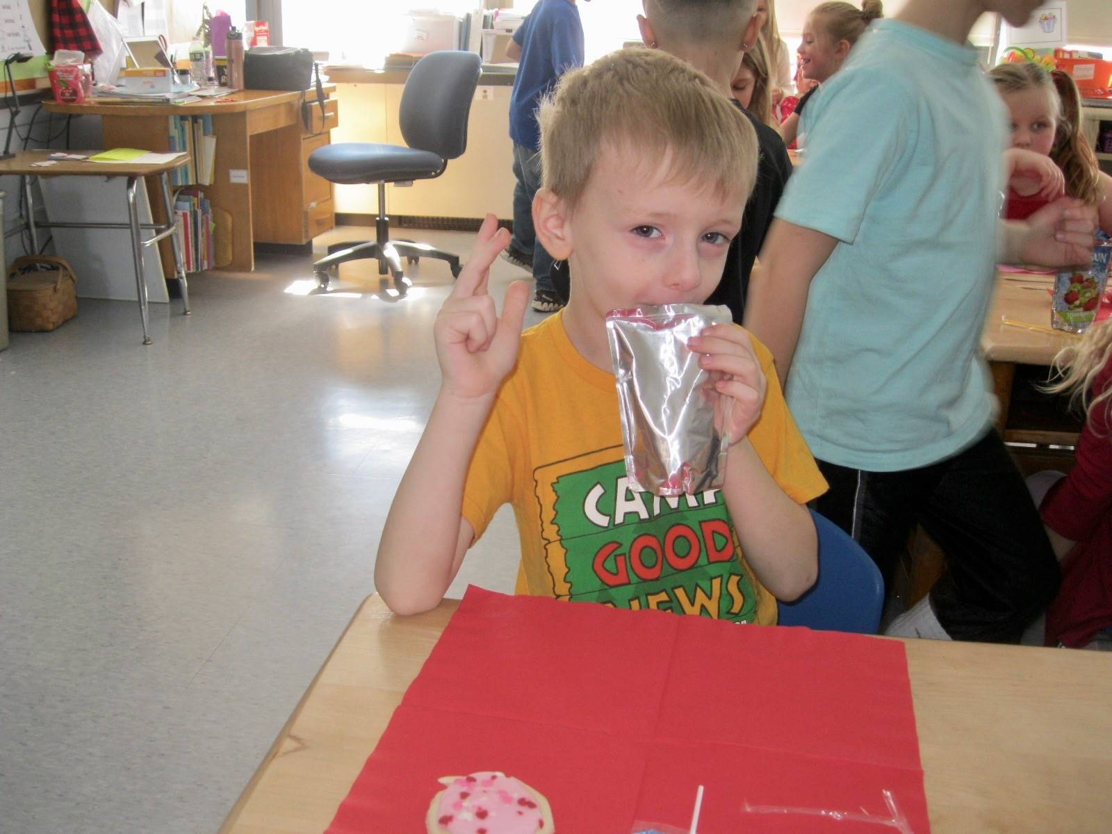 A student enjoys his party food.