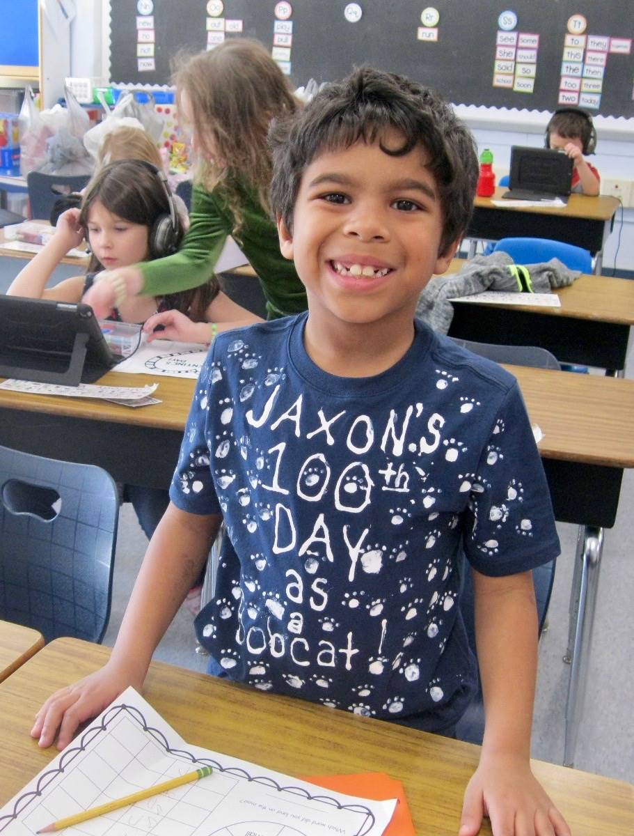 A student smiles.