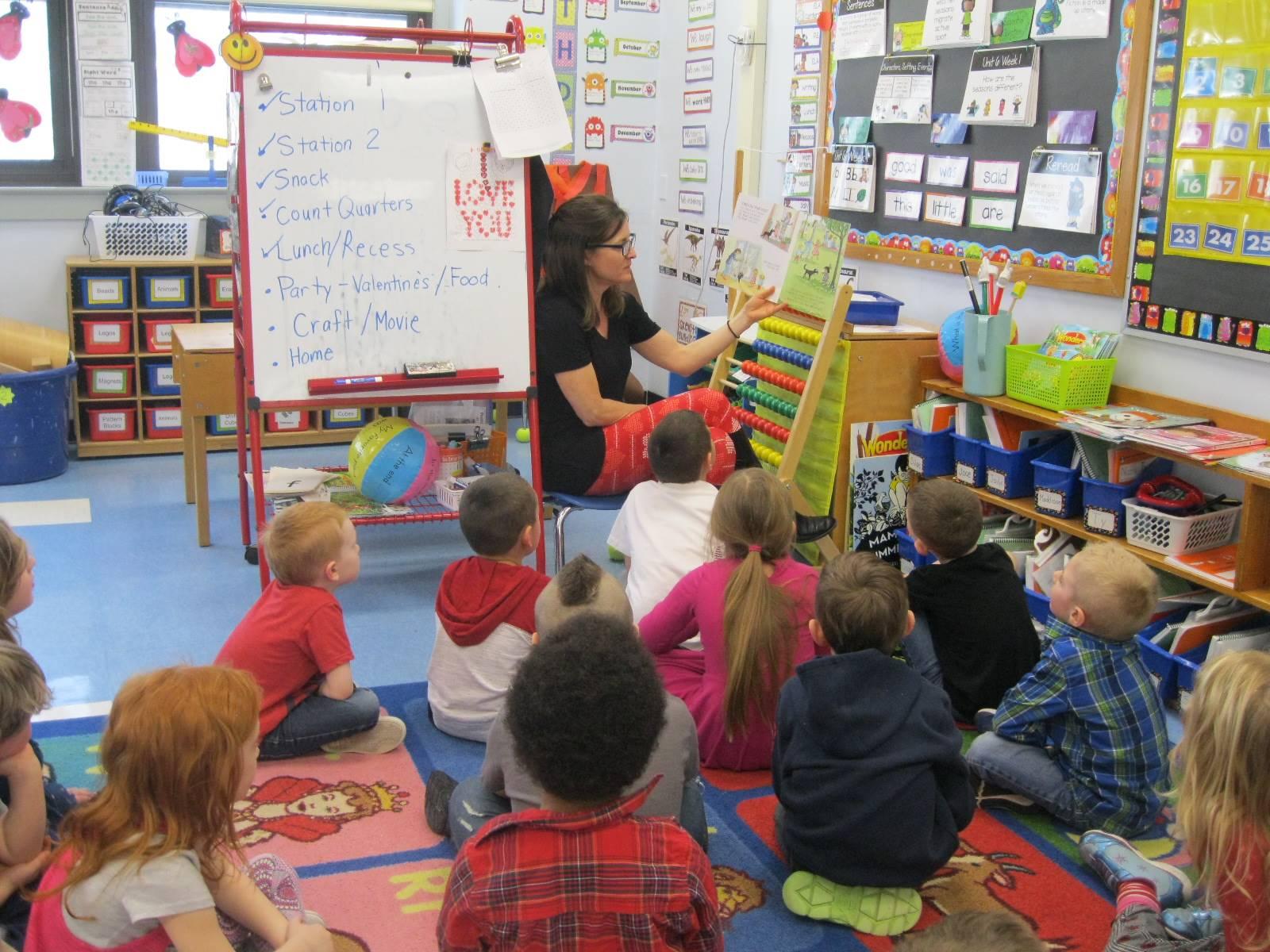 A teacher reads to her class.