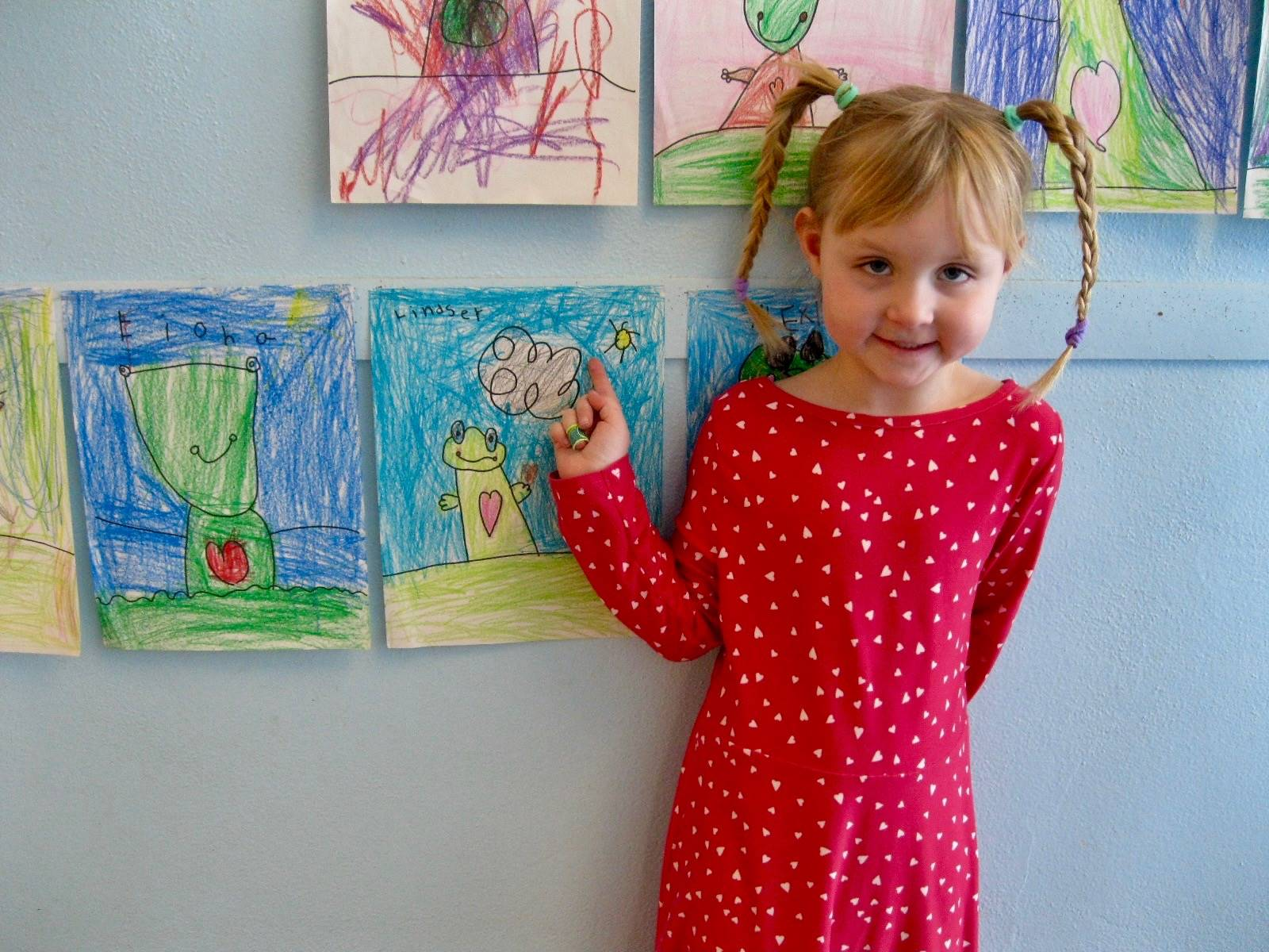 A student shows off her art.