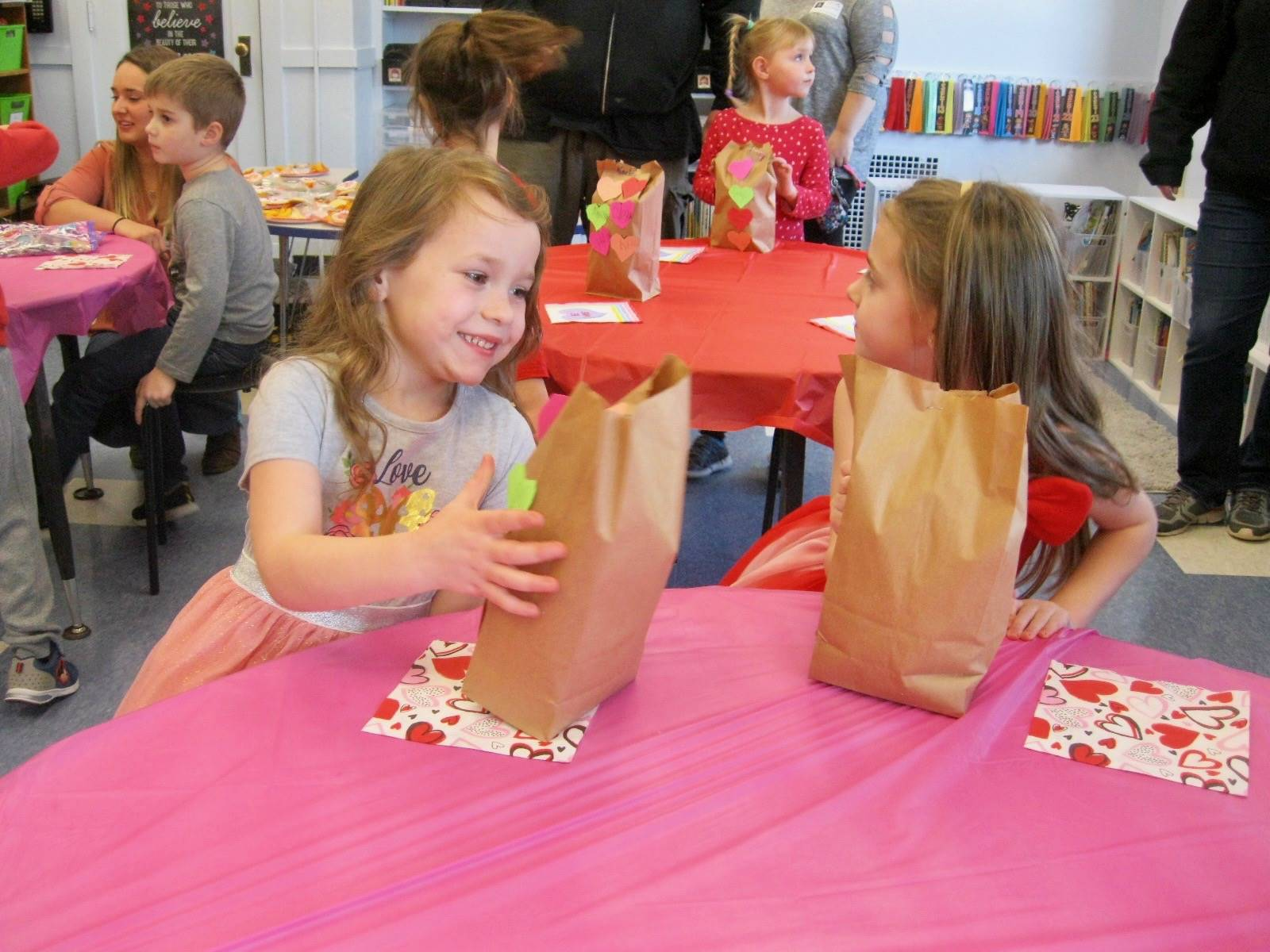 2 students open valentine cards.